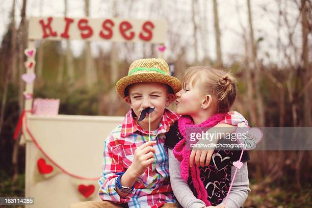 kids with kissing booth in background