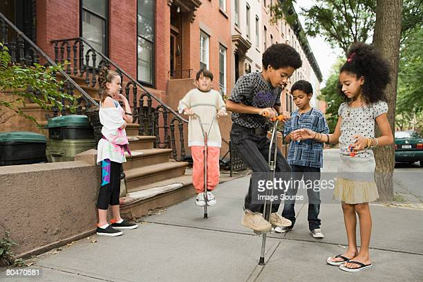 Kids with pogo sticks