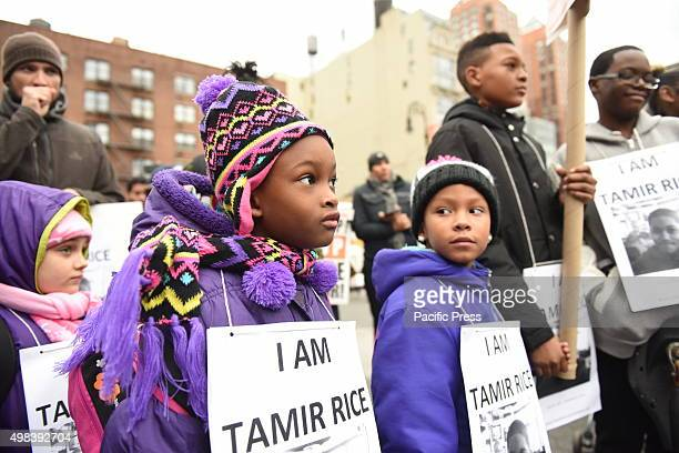 Kids with Tamir Rice signs Stop Mass Incarcerations Network sponsored a children's march demanding accountability on the one year anniversary of...