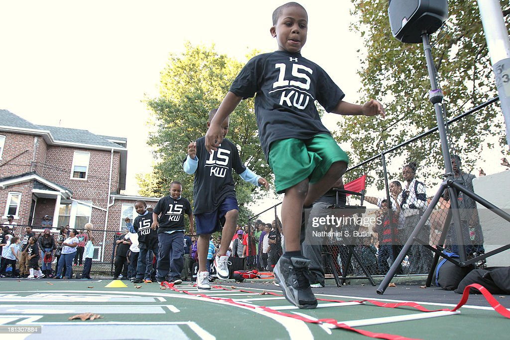 Kids work out during an Under Armour/NBA FIT - Basketball Court Refurbishment Dedication Ceremony on September 19, 2013 in New York, NY.