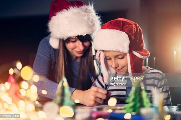 Kids writing letter to santa