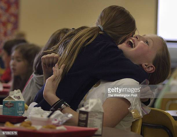 KidsPost profile on Ellie Shelton a 9 year old Herndon girl with juvenile diabetes Ellie gets a hug from friend Katie Pease during lunch at Neil...