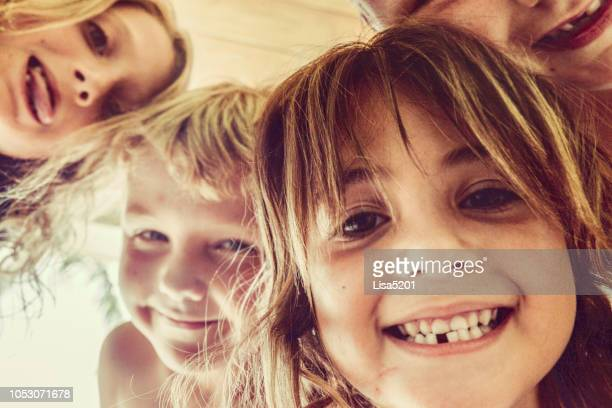 kidtopoia - four people stock pictures, royalty-free photos & images