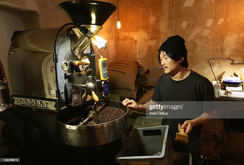 Kiduk Reus oversees freshly-roasted espresso coffee beans emerging from his refurbished 1918 Probat coffee bean roaster at Bonanza Coffee Roasters on January 24, 2011 in Berlin, Germany. Reus is among a growing number of so-called third wave artisinal coffee bean roasters who are finding a niche market in Europe and the USA for their carefully-crafted and expensive coffee. Reus insists that the cast iron parts, the slow-roasting abilities and hands-on controls of his flame-roasting Probat machine allow him to develop the most flavour from his carefully selected beans.