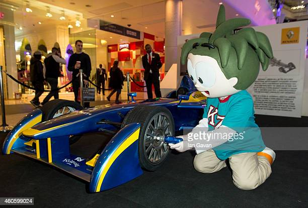 KidZania RightZkeeper Urbano changes the wheel of a three-quarters replica E.dams-Renault Formula E racing car as it is revealed by the ice rink at...