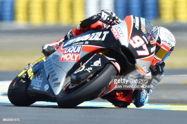 KTM Kiefer Racing Swiss' rider Dominique Aegerter competes and clocked the second place during a Moto2 qualifying session ahead of the French...