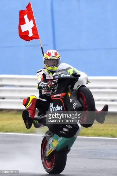 Kiefer Racing's Swiss rider Dominique Aegerter celebrates after winning the San Marino Moto2 Grand Prix race at the Marco Simoncelli Circuit in...