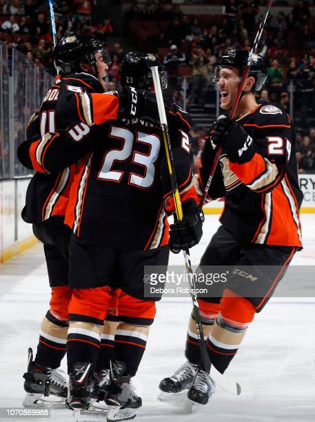 Kiefer Sherwood Carter Rowney and Brian Gibbons of the Anaheim Ducks celebrate  a goal in the. New Jersey Devils ... e27d55bf7