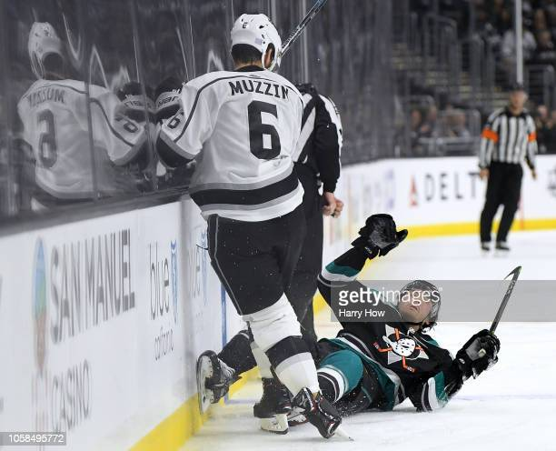 Kiefer Sherwood of the Anaheim Ducks falls to the ice after a bodycheck from Jake Muzzin of the Los Angeles Kings during the third period in a 41...