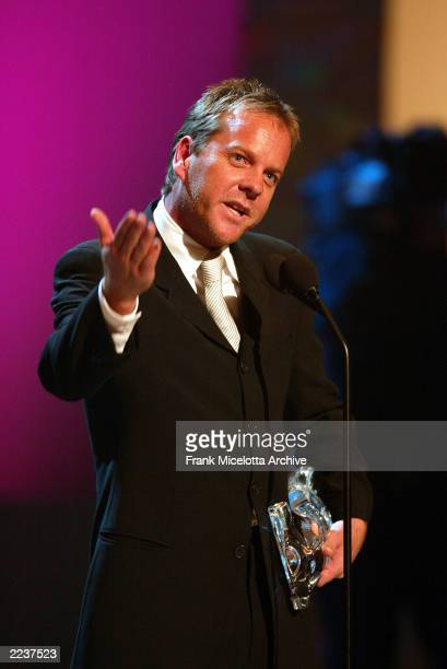 Kiefer Sutherland accepts the award for 'Dramatic Television Actor of the Year' on the 2002 GQ Men of the Year Awards at Hammerstein Ballroom in New...