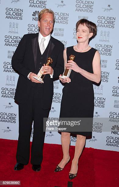 Kiefer Sutherland and Judy Davis in the press room at the 2001 Golden Globe awards with their awards for Best TV Actor in a Drama series and Best TV...