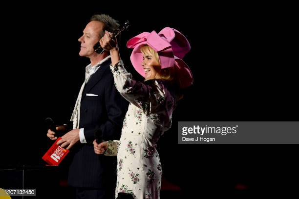 Kiefer Sutherland and Paloma Faith present an award on stage at The BRIT Awards 2020 at The O2 Arena on February 18, 2020 in London, England.