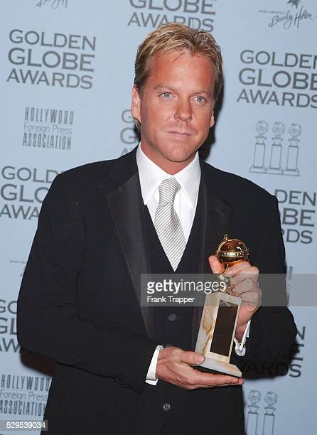 Kiefer Sutherland in the press room at the 2001 Golden Globe awards with his award for Best TV Actor in a Drama Series