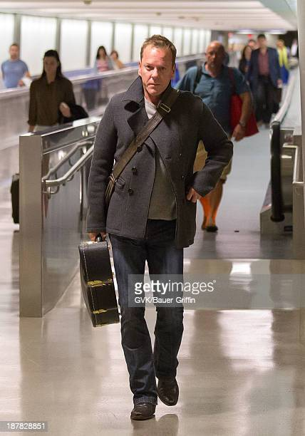 Kiefer Sutherland is seen arriving at Los Angeles International airport on November 12 2013 in Los Angeles California