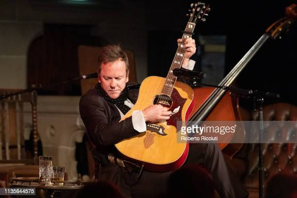 Kiefer Sutherland performs on stage at Cottiers Theatre on April 7 2019 in Glasgow Scotland