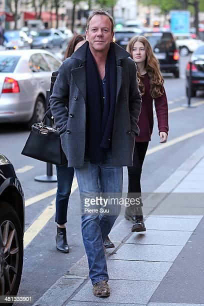 Kiefer Sutherland with his girlfriend and her daughter on vacation on March 29 2014 in Paris France