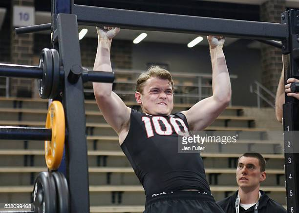 Kieffer Bellows does Pullups during the NHL Combine at HarborCenter on June 4 2016 in Buffalo New York