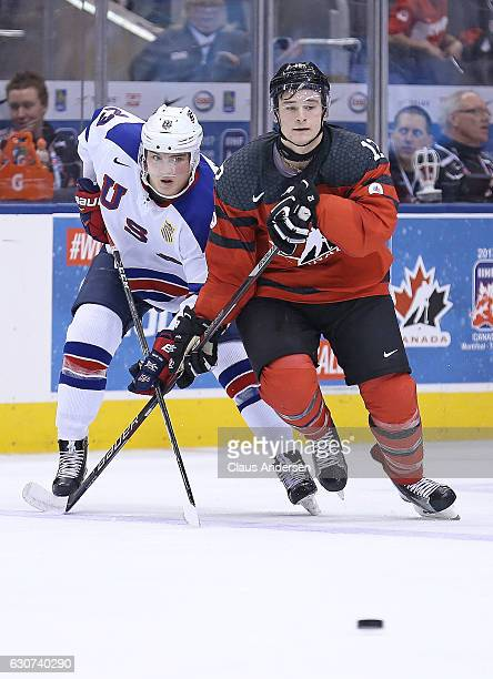 Kieffer Bellows of Team USA skates against Julien Gauthier of Team Canada during a preliminary round game in the 2017 IIHF World Junior Hockey...