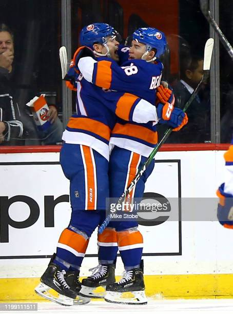 Kieffer Bellows of the New York Islanders is congratulated by his teammate Anthony Beauvillier after scoring his first NHL goal against the Los...