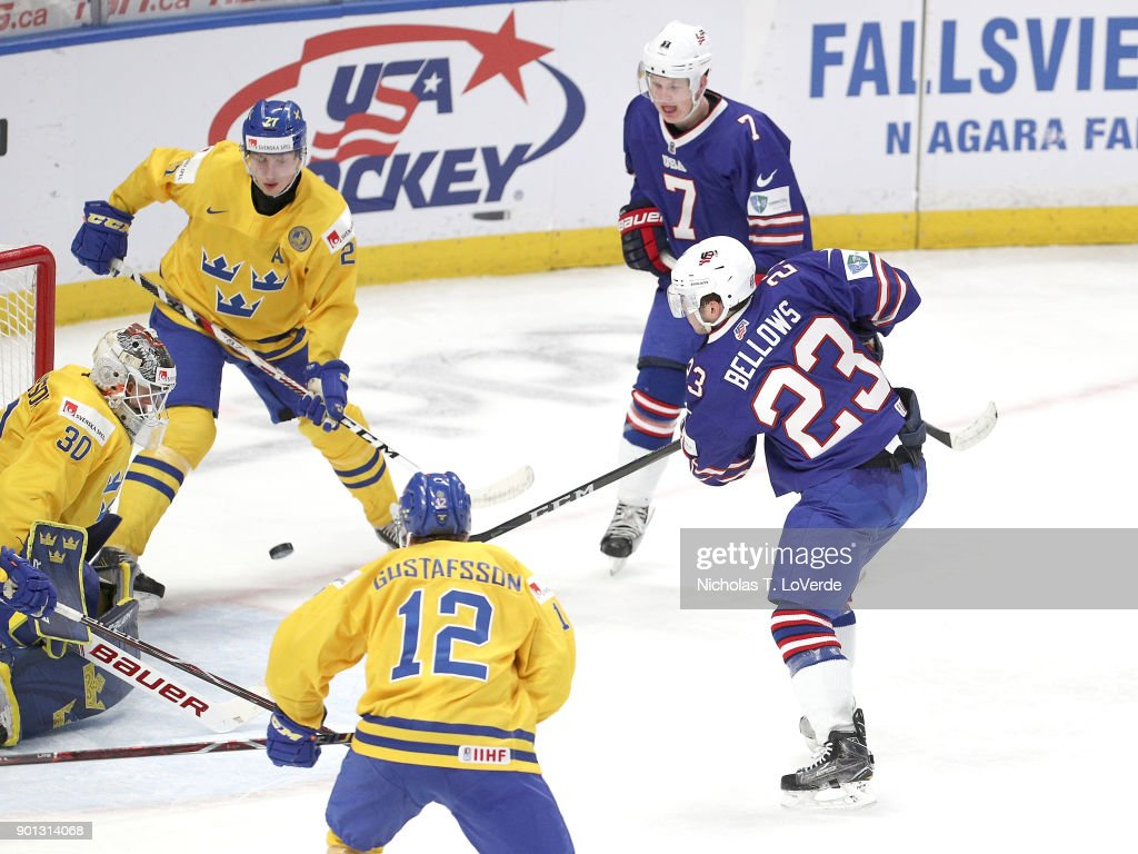 Kieffer Bellows #23 of United States beat Filip Gustavsson #30 of Sweden on this shot to cut the United States deficit to 4-1 during the third period of play in the IIHF World Junior Championships Semifinal game at KeyBank Center on January 4, 2018 in Buffalo, New York.