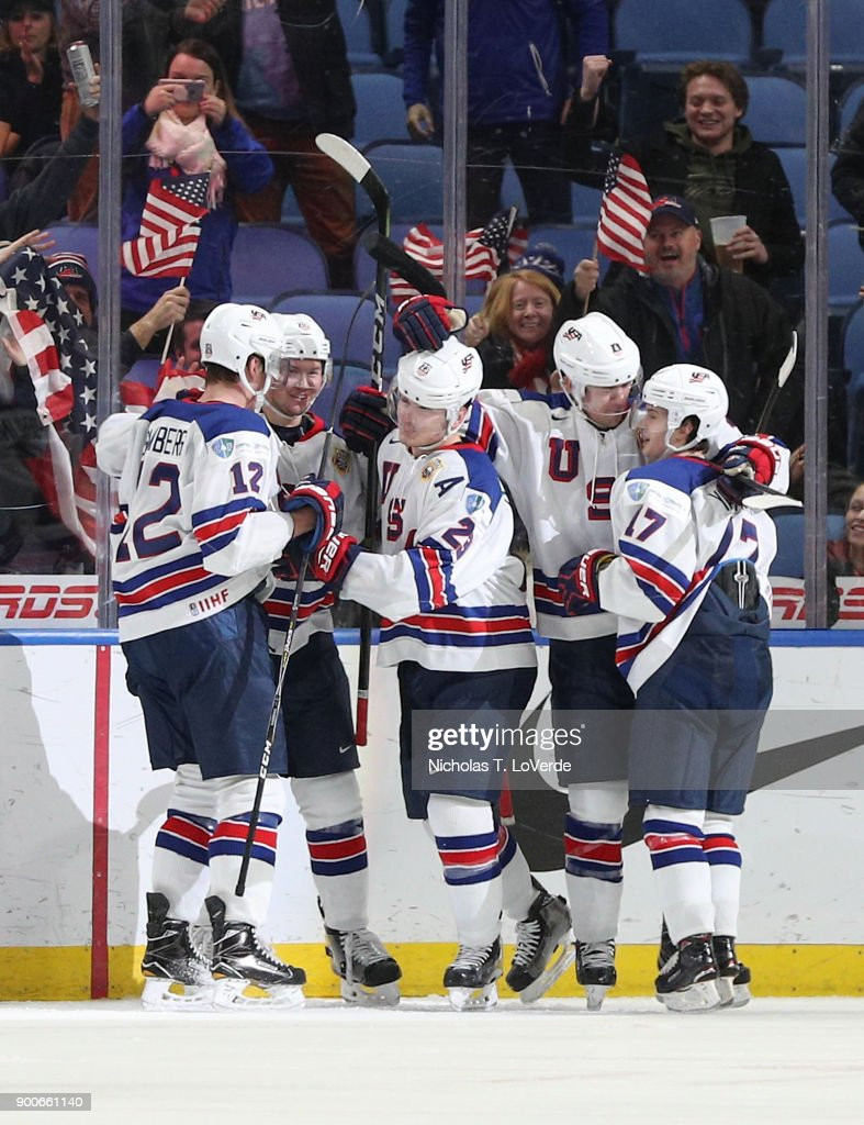 Kieffer Bellows #23 of United States celebrates his second goal of the game against team Russia with his teammates Dylan Samberg #12, Phil Kemp #25, Ryan Poehling #4 and Kailer Yamamoto #17 during the third period of play in the Quarterfinal IIHF World Junior Championship game at the KeyBank Center on January 2, 2018 in Buffalo, New York.