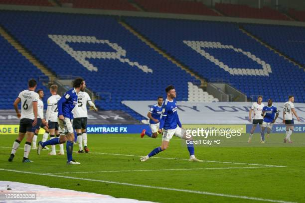 Kieffer Moore celebrates scoring the third goal for Cardiff City FC during the Sky Bet Championship match between Cardiff City and Luton Town at...