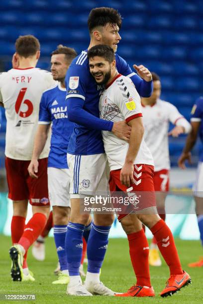 Kieffer Moore of Cardiff City embraces Sam Morsy of Middlesbrough at the end of the game during the Sky Bet Championship match between Cardiff City...