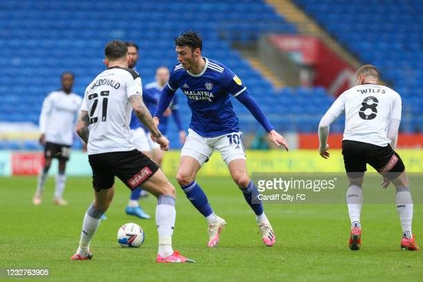 Kieffer Moore of Cardiff City FC and Angus MacDonald of Rotherham United during the Sky Bet Championship match between Cardiff City and Rotherham...