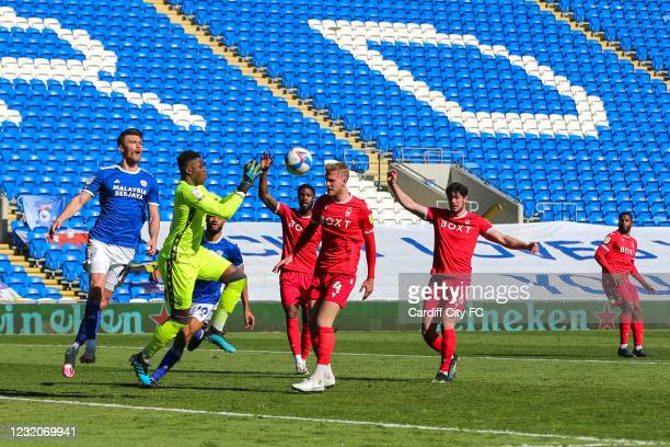 Kieffer Moore of Cardiff City FC and Brice Samba of Nottingham Forest during the Sky Bet Championship match between Cardiff City and Nottingham...