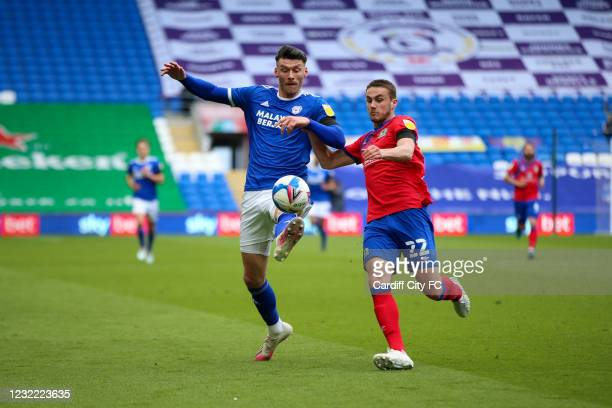 Kieffer Moore of Cardiff City FC and Taylor Harwood-Bellis of Blackburn Rovers during the Sky Bet Championship match between Cardiff City and...