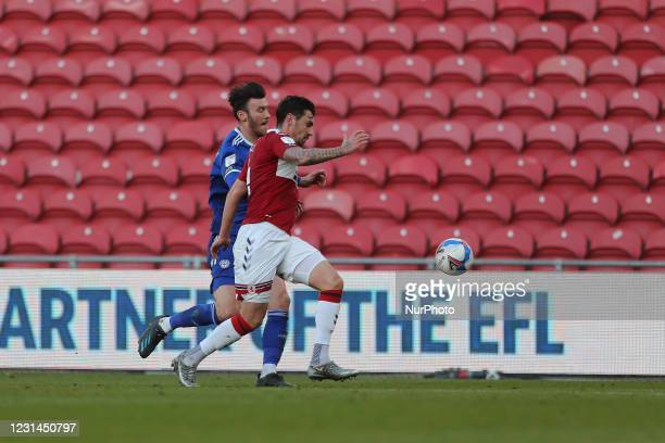 Kieffer Moore of Cardiff City in action with Grant Hall of Middlesbrough during the Sky Bet Championship match between Middlesbrough and Cardiff City...