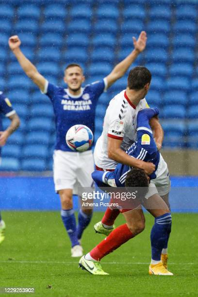 Kieffer Moore of Cardiff City is pushed down by a Middlesbrough player during the Sky Bet Championship match between Cardiff City and Middlesbrough...