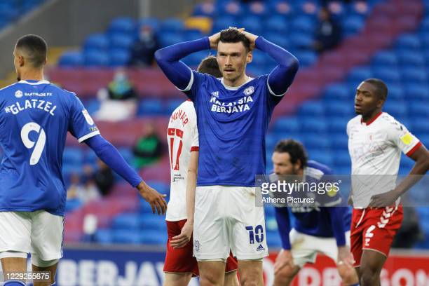 Kieffer Moore of Cardiff City rests his hands on his head in disappointment during the Sky Bet Championship match between Cardiff City and...