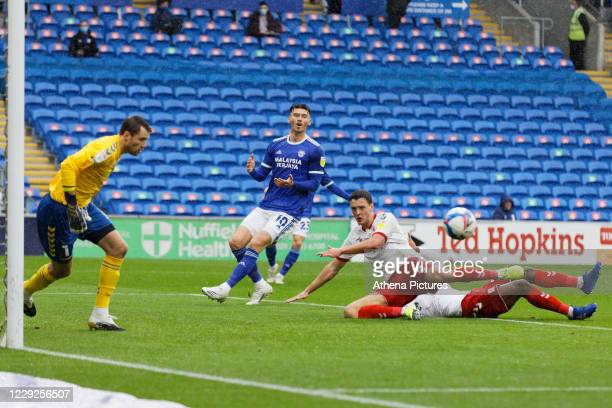 Kieffer Moore of Cardiff City watches on as the ball goes wide past Marcus Bettinelli and Dael Fry of Middlesbrough during the Sky Bet Championship...