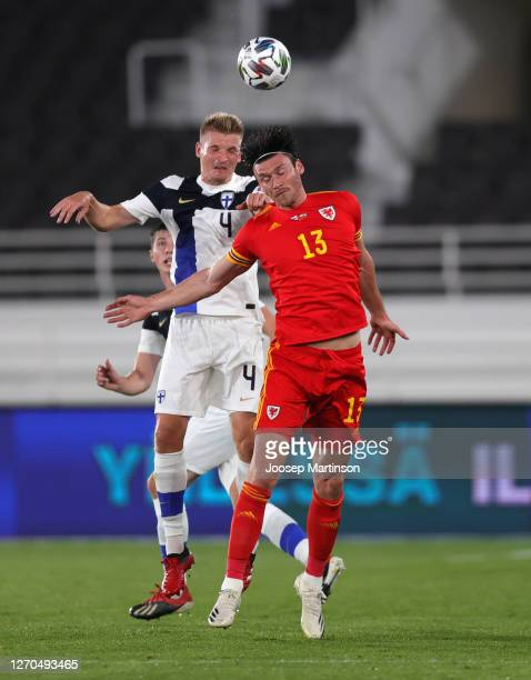 Kieffer Moore of Wales and Juhani Ojala of Finland compete for a header during the UEFA Nations League group stage match between Finland and Wales at...