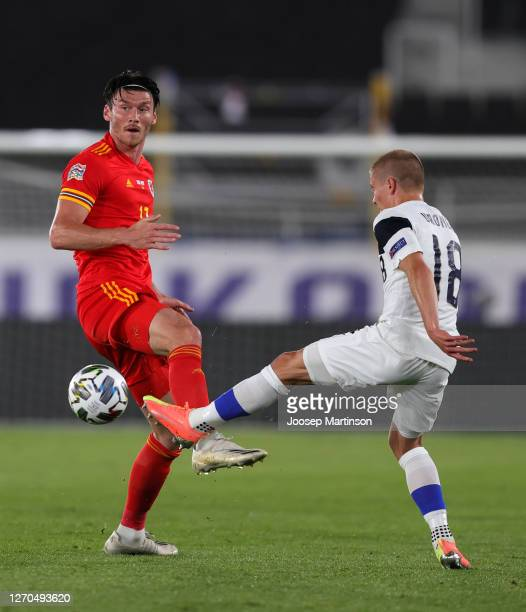 Kieffer Moore of Wales battles for possession with Jere Uronen of Finland during the UEFA Nations League group stage match between Finland and Wales...