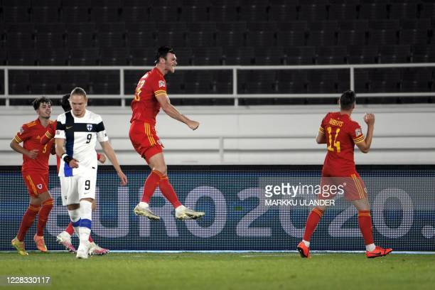 Kieffer Moore of Wales celebrates after scoring during the UEFA Nations League football match between Finland and Wales in Helsinki on September 3,...