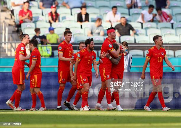 Kieffer Moore of Wales celebrates with team mates after scoring their side's first goal during the UEFA Euro 2020 Championship Group A match between...