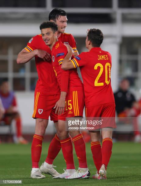 Kieffer Moore of Wales celebrates with teammates Ethan Ampadu and Daniel James of Wales after scoring his team's first goal during the UEFA Nations...