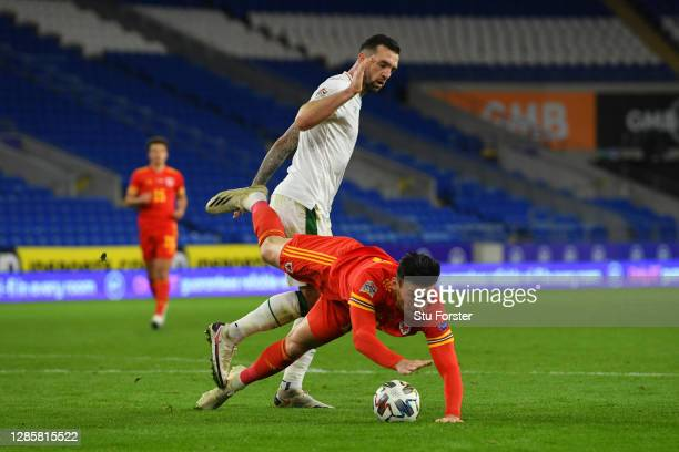Kieffer Moore of Wales dives after a clash with Shane Duffy of Republic of Ireland and later receives a yellow card during the UEFA Nations League...