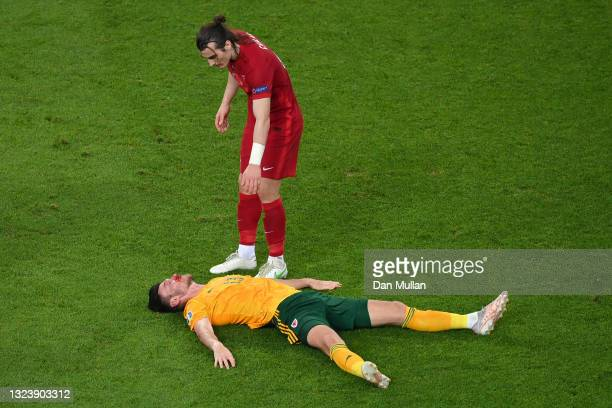 Kieffer Moore of Wales goes down injured after a challenge from Caglar Soyuncu of Turkey during the UEFA Euro 2020 Championship Group A match between...