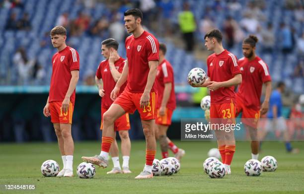 Kieffer Moore of Wales looks on as he warms up prior to the UEFA Euro 2020 Championship Group A match between Italy and Wales at Olimpico Stadium on...