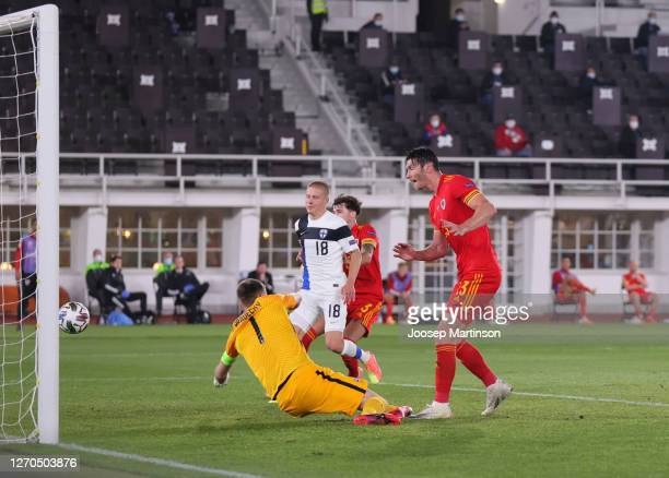 Kieffer Moore of Wales scores his team's first goal during the UEFA Nations League group stage match between Finland and Wales at Helsingin...