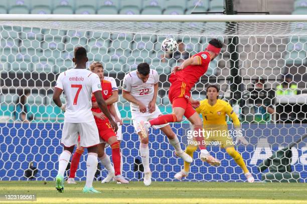 Kieffer Moore of Wales scores their side's first goal past Yann Sommer of Switzerland during the UEFA Euro 2020 Championship Group A match between...
