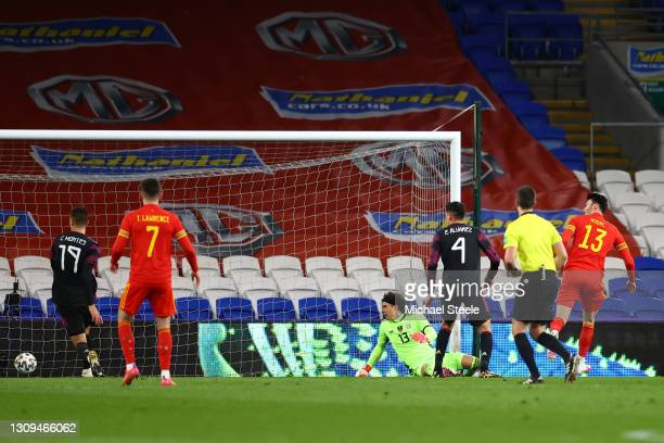 Kieffer Moore of Wales scores their team's first goal past Guillermo Ochoa of Mexico during the International Friendly match between Wales and Mexico...