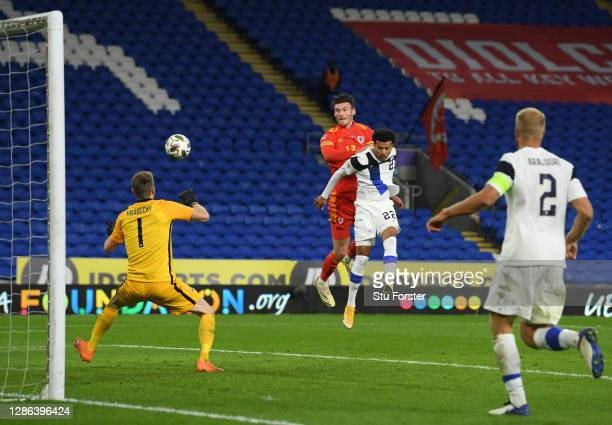 Kieffer Moore of Wales scores their team's third goal past Lukas Hradecky of Finland during the UEFA Nations League group stage match between Wales...