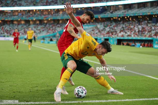 Kieffer Moore of Wales shields the ball from Kaan Ayhan of Turkey during the UEFA Euro 2020 Championship Group A match between Turkey and Wales at...