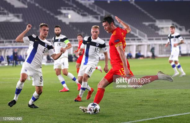Kieffer Moore of Wales shoots under pressure from Leo Vaaisaanen of Finland and Ilmari Niskanen of Finland during the UEFA Nations League group stage...