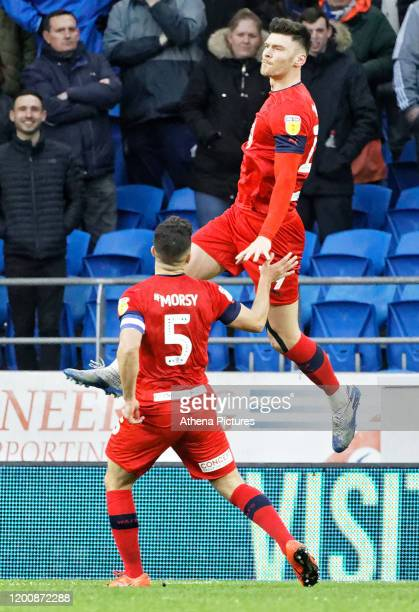Kieffer Moore of Wigan Athletic celebrates his second goal with team mate Sam Morsy during the Sky Bet Championship match between Cardiff City and...