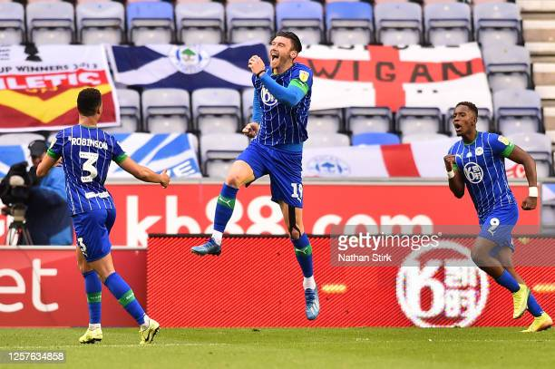 Kieffer Moore of Wigan Athletic celebrates with teammates after scoring his team's first goal during the Sky Bet Championship match between Wigan...